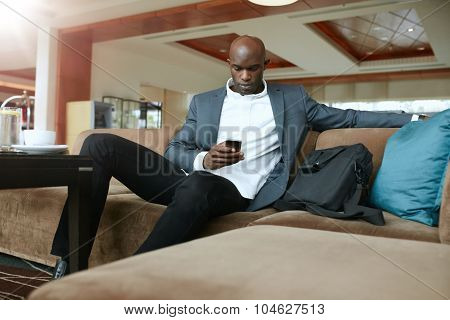 Business Executive Waiting In Hotel Lobby