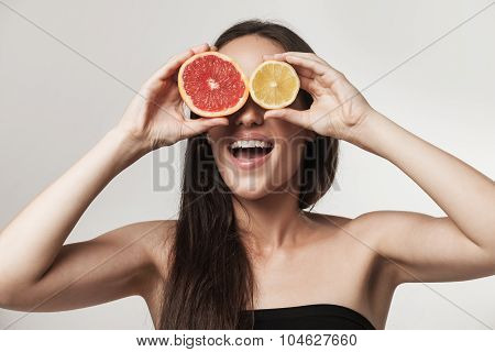 Portrait Of Young Woman Holning Lemon Ang Grapefruit