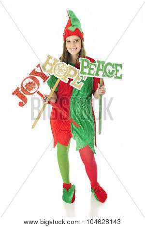 A pretty teen elf happily holding signs of Christmas wishes:  Joy, Hope and Peace.  On a white background.