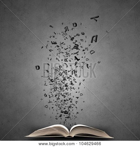 Opened book with characters flying of pages