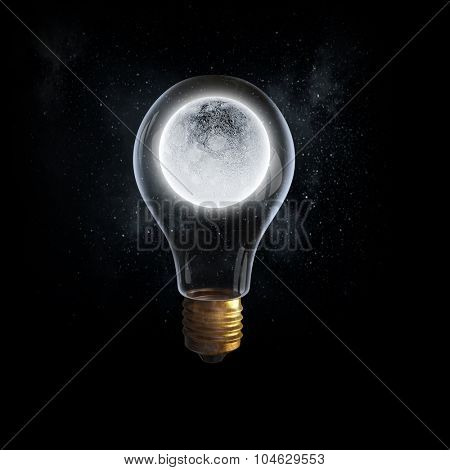 Glass light bulb with moon planet inside