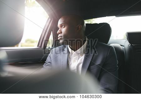 African Businessman Traveling To Work In The Luxury Car