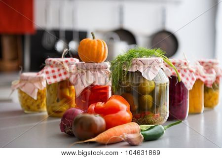 Closeup Of Preserved Vegetables In Glass Jars