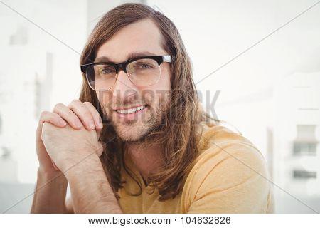 Portrait of happy hipster wearing eye glasses in office