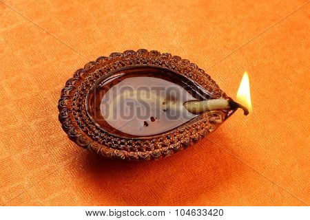 Hindu Festival Diwali Diya On Orange Background