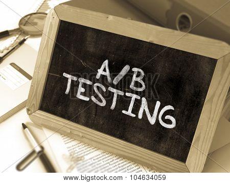 AB Testing Handwritten on Chalkboard.