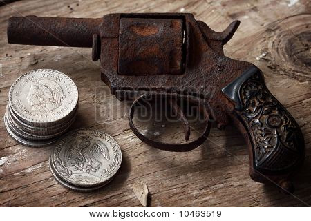 Revolver And Mexican Coins
