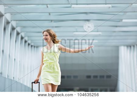 Young girl with a suitcase at the airport