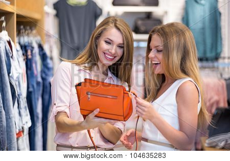 Young smiling woman in a store