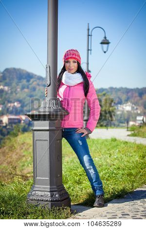Young woman posing outdoor in autumn