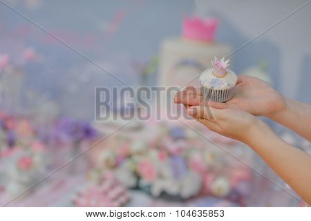 Holding A Cupcake