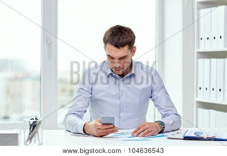 business, people, stress and technology concept - close up of businessman with smartphone