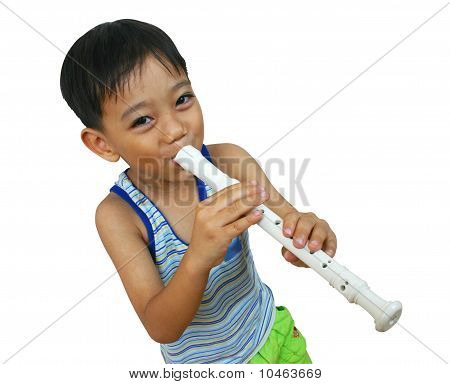 Young boy playing flute