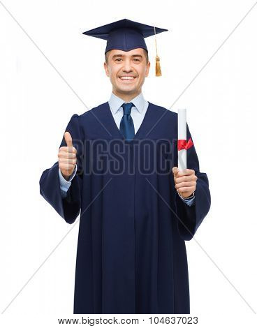 education, graduation, gesture and people concept - smiling adult student in mortarboard with diploma showing thumbs up