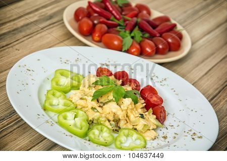 Scrambled Eggs With Paprika, Cherry Tomatoes, Chili Peppers And Celery Leaves