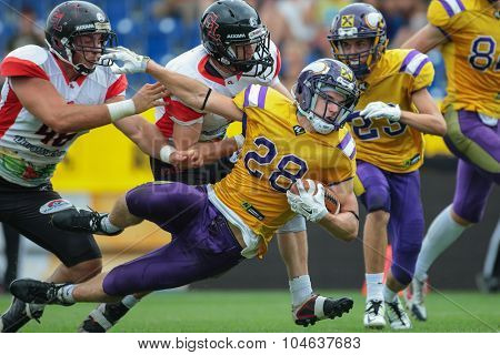 ST. POELTEN, AUSTRIA - JULY 26, 2014: RB Alexander Hertel (#28 Vikings) runs with the ball during Silver Bowl XVII.