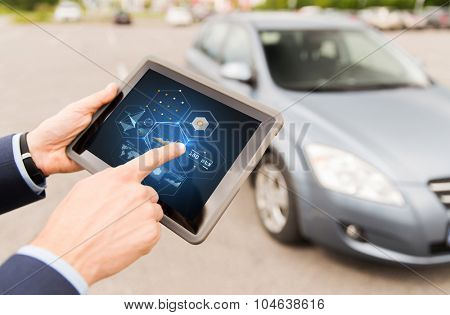 vehicle, technology, diagnostics and people concept - close up of male hands with charts on tablet pc computer screen and car outdoors
