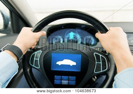 transport, business trip, technology and people concept - close up of male hands holding car wheel and driving with icon on board computer screen
