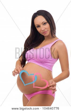 Beautiful Future Mother Waiting Baby. Boy, Girl Twins. Blue And Pink Hearts At The Pregnant Belly.