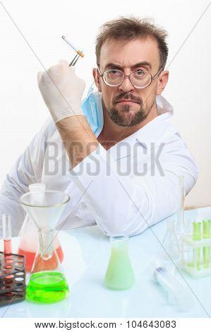 Crazy chemist smokes a cigarette
