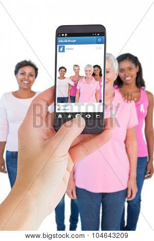 Female hand holding a smartphone against photo sharing app