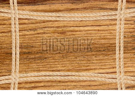 Frame Composed Of Rope Over Wooden Background