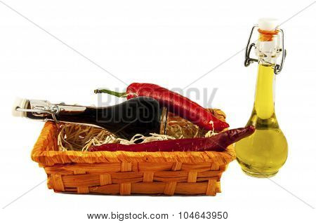 Two Bottles Of Wine Vinegar, Olive Oil And Two Red Hot Chilly Peppers  In A Gift Box