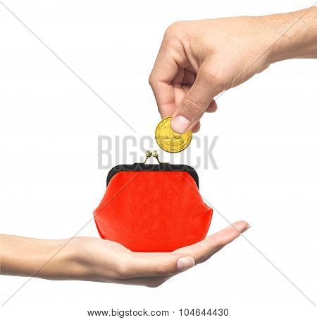 Red Purse In Woman Hand And Man Hand With Coin Isolated On White