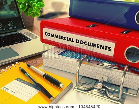 Red Office Folder with Inscription Commercial Documents.