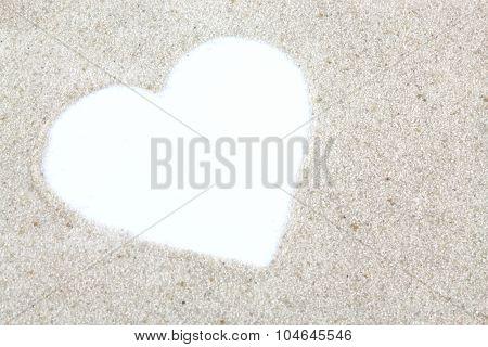 White Heart On Beach Background
