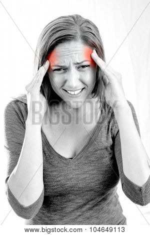 Woman holding her head in pain with headache - black and white