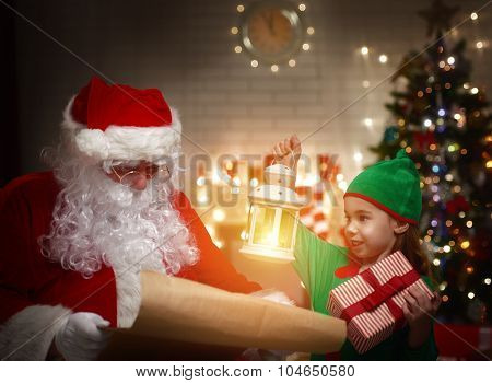 Cute elf helps Santa Claus reading wish list