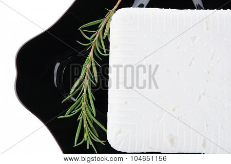 image of soft cheese on black dish