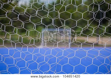 Goal Net With Blurred Of Futsal Court