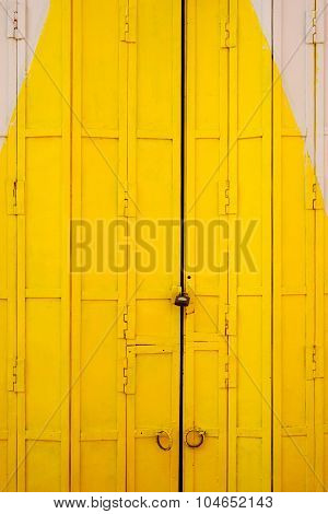 Old Yellow White Foldable Iron Door Close-up Background