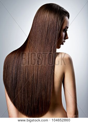 Portrait of beautiful woman with long straight brown hair at studio