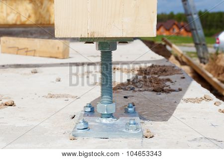 Closeup of wooden pillar on the construction site with screw. Wooden Pillars are structures that can be placed on Foundations or Platforms.