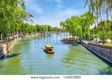 Beijing, China- May 18, 2015 :beautiful Beihai Park, Boat On A Pond With Peoples, Near The Forbidden