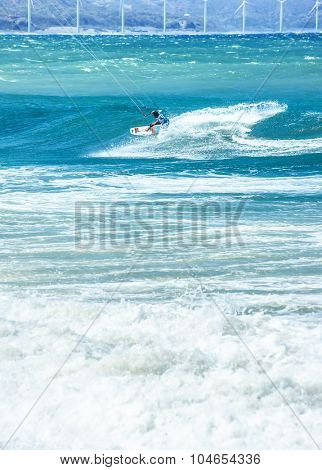 Vertical composition view of kite-surfer having fun in ocean water at summer