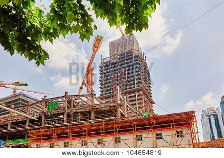 Skyscraper Building Under Construction In Summer Day.