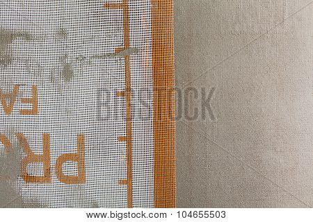 Closeup of facade layers over mesh plaster and cement