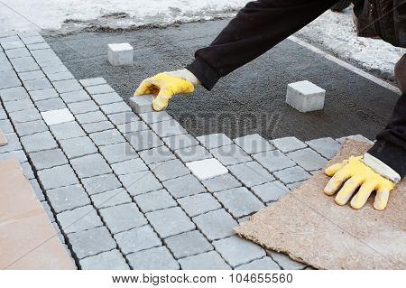 Bricklayer Installing Brick Patio