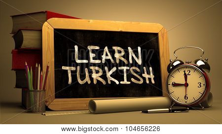 Hand Drawn Learn Turkish Concept on Chalkboard.