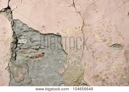 Cracked  Building Stone Wall With Fractured Plaster Covering Texture