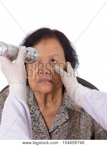 Neurologist Testing Reflexes Of The Eye Of Young Woman