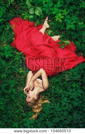 Beautiful Young Woman In Fashion Red Dress