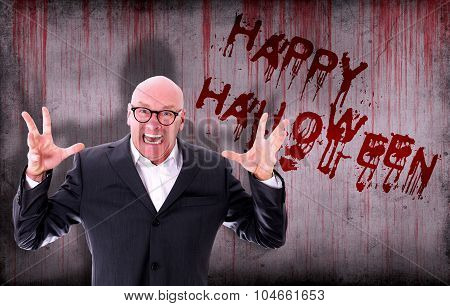 Happy Halloween Sprayed On Wall Next To Screaming Businessman