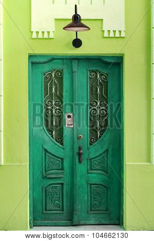 House Wall With Retro Green Door And Old Hanging Lamp