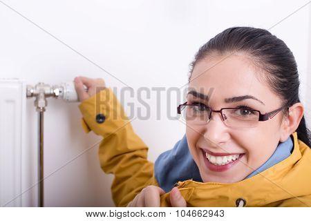 Woman In Jacket Adjusting Heating