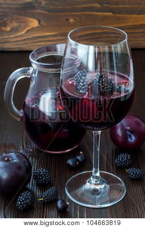 Black sangria with plums and berries.